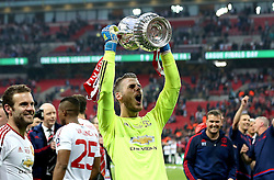 David De Gea of Manchester United celebrate winning the FA Cup with the Trophy - Mandatory by-line: Robbie Stephenson/JMP - 21/05/2016 - FOOTBALL - Wembley Stadium - London, England - Crystal Palace v Manchester United - The Emirates FA Cup Final