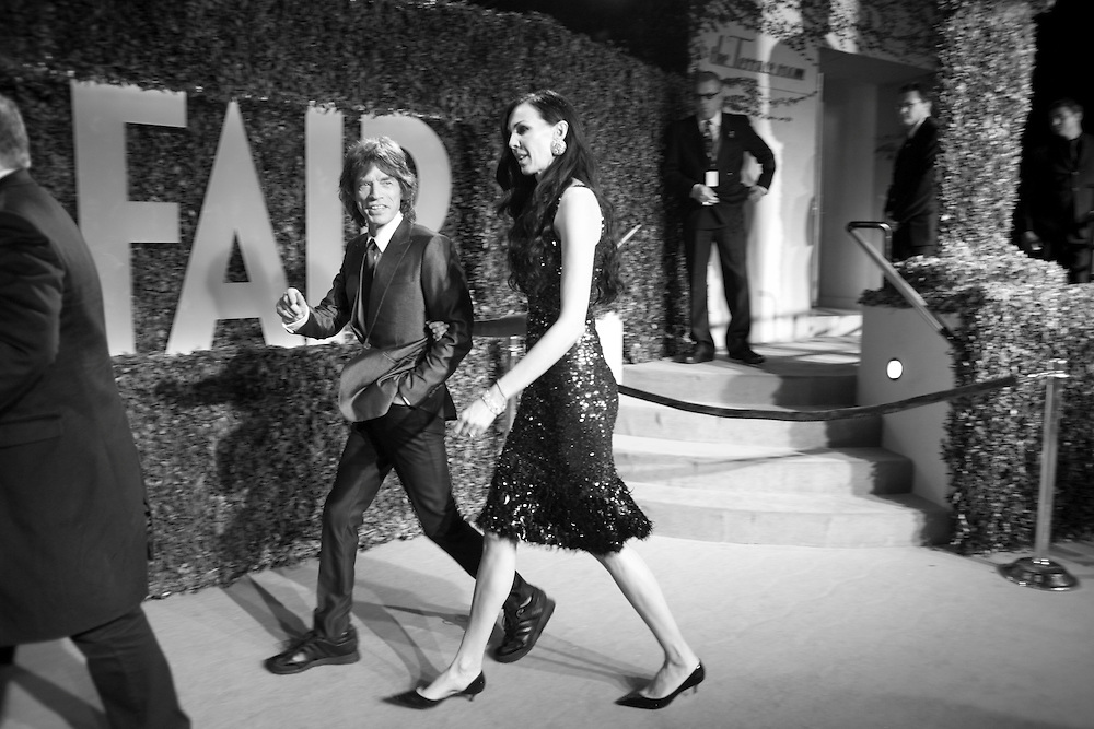 MICK JAGGER; L'WREN SCOTT, Vanity Fair Oscar night party hosted by Graydon Carter. Sunset Tower Hotel, West Hollywood. 22 February 2009, Vanity Fair Oscar night party hosted by Graydon Carter.  Sunset  Tower Hotel, West Hollywood. 22 February 2009.