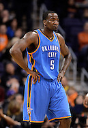 Jan. 14, 2013; Phoenix, AZ, USA; Oklahoma City Thunder center Kendrick Perkins (5) walks up the court during the game against the Phoenix Suns at the US Airways Center. The Thunder defeated the Suns 102-90. Mandatory Credit: Jennifer Stewart-USA TODAY Sports