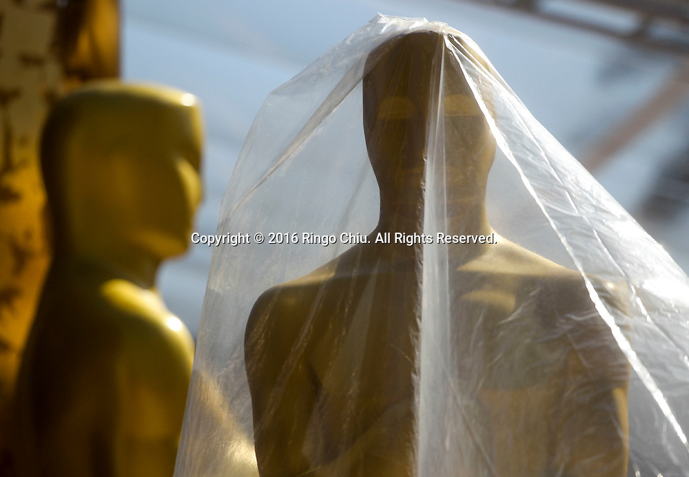 An Oscar statue wrapped in a plastic bag stands at the red carpet arrivals area in front of the Dolby Theatre on Thursday Feb. 25, 2016 in Los Angeles. The 88th Academy Awards will be held Sunday, February 28, 2016. (Photo by Ringo Chiu/PHOTOFORMULA.com)<br /> <br /> Usage Notes: This content is intended for editorial use only. For other uses, additional clearances may be required.