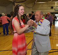 Katey Fecteau and John Gauthier enjoy a dance together during Laconia High School's Senior / Senior Hawaiian themed prom held at the Laconia Community Center Thursday evening.  Mr. Gauthier is a 1938 graduate of LHS and served as class president for two years.  (Karen Bobotas/for the Laconia Daily Sun)