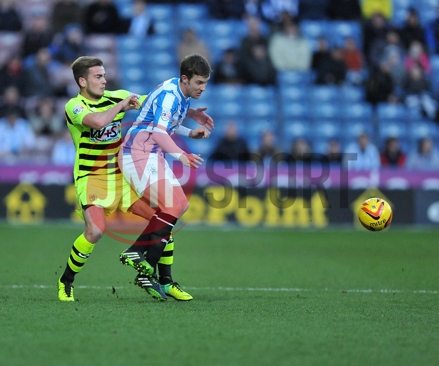 Yeovil Town's Joe Ralls battles for the ball with Huddersfield Town's Paul Dixon - Photo mandatory by-line: Alex James/JMP - Tel: Mobile: 07966 386802 29/12/2013 - SPORT - FOOTBALL - John Smith's Stadium - Huddersfield - Huddersfield Town v Yeovil Town - Sky Bet Championship