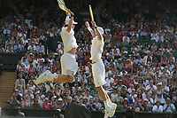 Tennis - 2013 Wimbledon Championships - Mens Doubles Final<br /> Centre Court<br /> <br /> Bob Bryan and Mike Bryan against Ivan Dodig and Marcelo Melo<br /> Bob Bryan and Mike Bryan celebrate at match point
