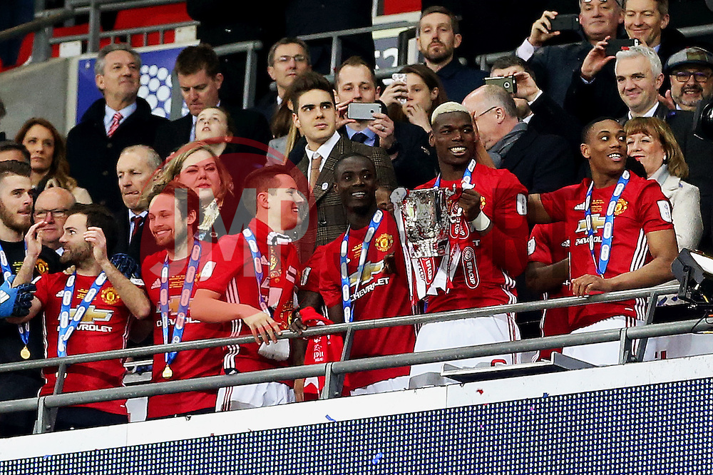 Paul Pogba of Manchester United lifts the EFL Trophy with his team mates - Mandatory by-line: Matt McNulty/JMP - 26/02/2017 - FOOTBALL - Wembley Stadium - London, England - Manchester United v Southampton - EFL Cup Final