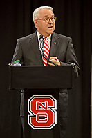 Chancellor Randy Woodson introduces new athletics director Boo Corrigan in Reynolds Coliseum.