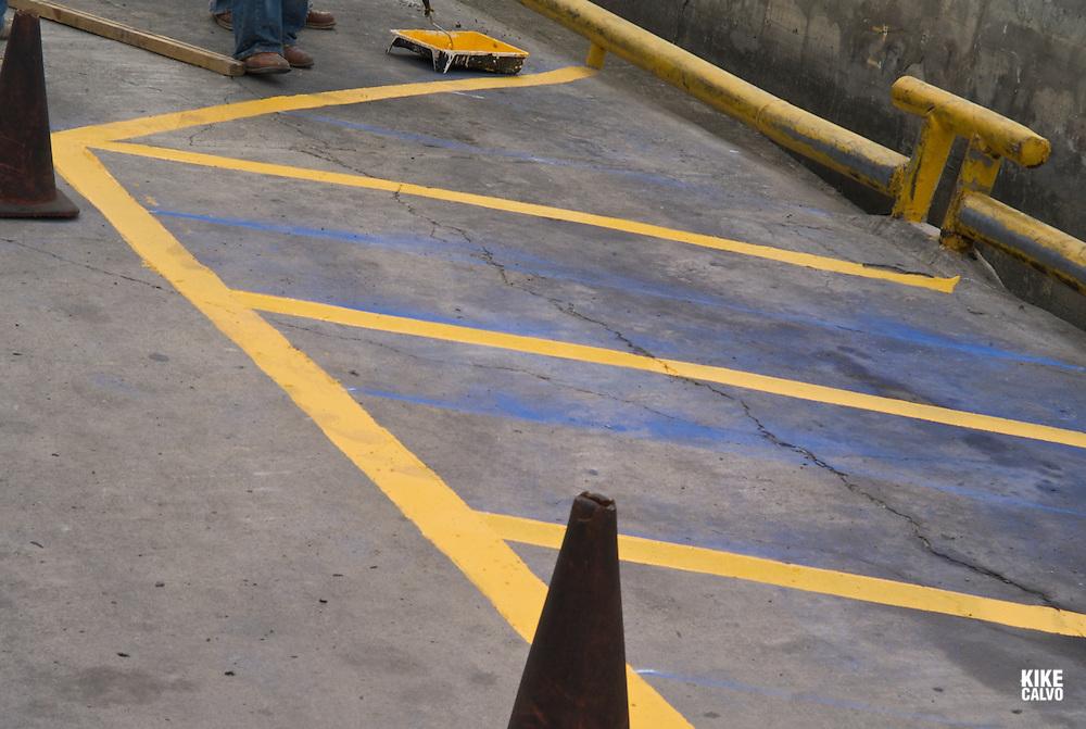 Fuerte Amador Resort and Marina. Isla Flamenco. Painting yellow and blue lines.