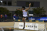 May 24, 2019; Sacramento, CA, USA; Andrew Gardner (434) of Gonzaga races over the water jump in the steeplechase during the NCAA West Preliminary at Hornet Stadium.