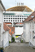 Houses and narrow streets in the old part of Stavanger, Norway, locally known as 'Gamle Stavanger'. The 173 buildings date back to 1700- and 1800-century and compose the best preserved wooden buildings in northern Europe. In the background is the cruise ship Oceana of Hamilton, UK, that visited Stavanger in May 2014.