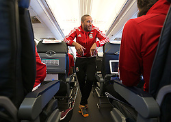 ZENICA, BOSNIA & HERZEGOVINA - Sunday, October 11, 2015: Wales' captain Ashley Williams on the team's return flight to Cardiff after qualifying for the UEFA Euro 2016 finals despite a 2-0 defeat to Bosnia and Herzegovina during the UEFA Euro 2016 qualifying match. (Pic by David Rawcliffe/Propaganda)
