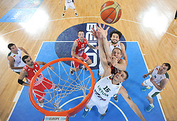 Luka Zoric #14 of Croatia between Linas Kleiza #11 of Lithuania and Roberas Javtokas #15 of Lithuania during basketball match between National teams of Lithuania and Croatia in Semifinals at Day 17 of Eurobasket 2013 on September 20, 2013 in Arena Stozice, Ljubljana, Slovenia. (Photo by Vid Ponikvar / Sportida.com)