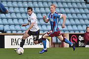 Craig Jones (14) of Bury and Luke Williams of Scunthorpe United  during the Sky Bet League 1 match between Scunthorpe United and Bury at Glanford Park, Scunthorpe, England on 19 April 2016. Photo by Ian Lyall.