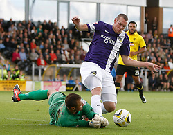 Burton Albion's Dean Lyness saves under pressure from Oxford United's James Constable  - Photo mandatory by-line: Matt Bunn/JMP - Tel: Mobile: 07966 386802 07/09/2013 - SPORT - FOOTBALL -  Pirelli Stadium - Burton upon Trent - Burton Albion V Oxford United - Sky Bet League Two
