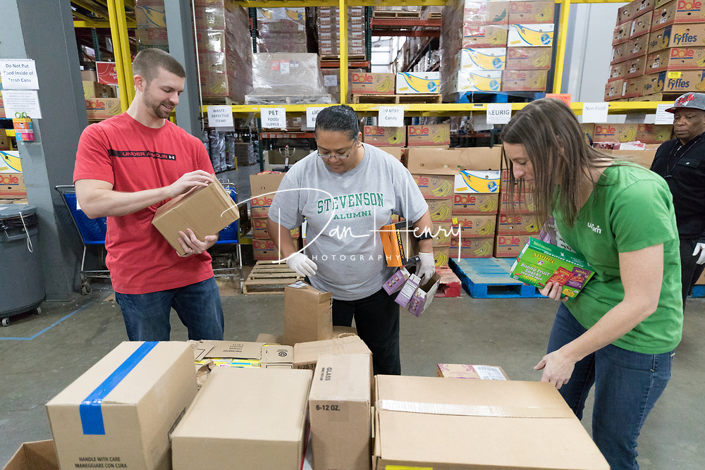 UNUM veteran employees volunteer at the Chattanooga Area Food Bank on March 2, 2018. Photo by Dan Henry / DanHenryPhotography.com
