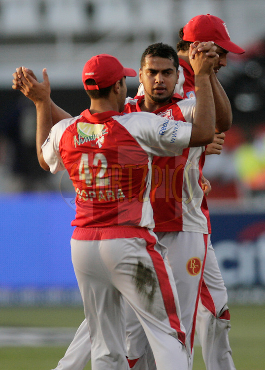 DURBAN, SOUTH AFRICA - 24 April 2009. Yusuf Abdulla celebrates the wicket of Jesse Ryder with Yuvraj Singh and Ravi Bopara during the IPL Season 2 match between the Royal Challengers Bangalore and the Kings X1 Punjab held at Sahara Stadium Kingsmead, Durban, South Africa...