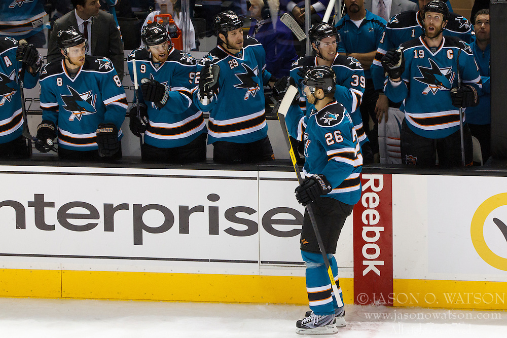 Mar 24, 2012; San Jose, CA, USA; San Jose Sharks center Michal Handzus (26) is congratulated by teammates after scoring a goal against the Phoenix Coyotes during shootouts at HP Pavilion.  San Jose defeated Phoenix 4-3 in shootouts. Mandatory Credit: Jason O. Watson-US PRESSWIRE