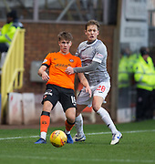 12th January 2019, Tannadice Park, Dundee, Scotland; Scottish Championship football, Dundee United versus Dunfermline Athletic; Matthew Smith of Dundee United challenges for the ball with James Craigen of Dunfermline Athletic