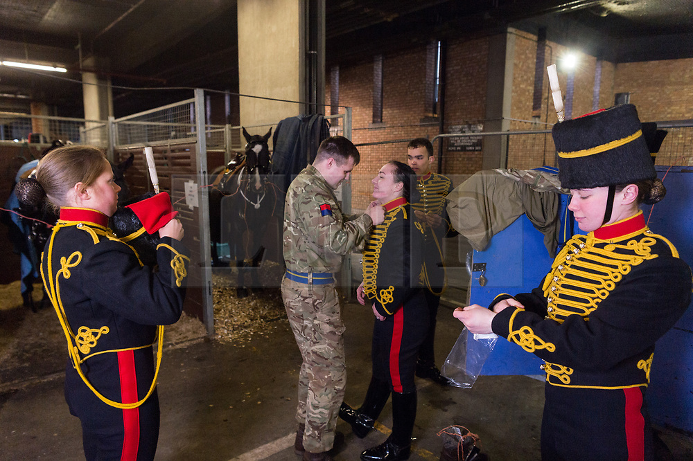 © Licensed to London News Pictures. 06/02/2018. London, UK. Members of The KIng's Troop Royal Horse Artillery prepare their horses in  temporary stables in Wellington Barrack. The KIng's Troop Royal Horse Artillery will ride with horses and gun carriages taking part in a 41 gun salute to mark the anniversary of the Accession of Her Majesty The Queen.  Photo credit: Ray Tang/LNP