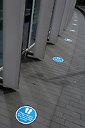 "Social distance markers are on the ground at the entrance to the Roof Garden for when this popular rooftop viewpoint across the capital re-opens again when restrictions of the UK Coronavirus pandemic lockdown rules are realxed further. The number of deaths from Coronavirus in the last 24hrs has increased by 287 to 37,979 while the UK government lowered the national Covid-19 alert level from 4 to 3, meaning the virus is considered to be ""in general circulation .. with ""a gradual reduction in restrictions"", on 19th June 2020, in the City of London, England."