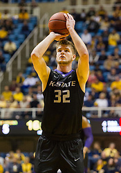 Jan 26, 2016; Morgantown, WV, USA; Kansas State Wildcats forward Dean Wade (32) shoots a free throw during the first half against the West Virginia Mountaineers at the WVU Coliseum. Mandatory Credit: Ben Queen-USA TODAY Sports