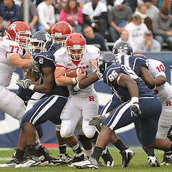 Oct 31, 2009; East Hartford, CT, USA; Rutgers running back Joe Martinek (38) runs through arm tackles during second half Big East NCAA football action in Rutgers' 28-24 victory over Connecticut at Rentschler Field.