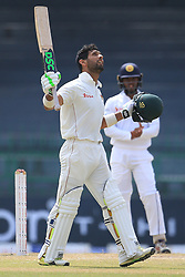 July 17, 2017 - Colombo, Sri Lanka - Zimbabwe cricketer Sikandar Raza raises his bat and look up at the sky after scoring 100 runs during the 4th day's play in the only Test match between Sri Lanka and Zimbabwe at ..R Premadasa International Cricket Stadium in the capital city of Colombo, Sri Lanka on Monday  17th July 2017  (Credit Image: © Tharaka Basnayaka/NurPhoto via ZUMA Press)