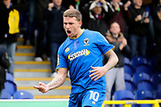 AFC Wimbledon striker Cody McDonald (10) celebrating after scoring goal during the The FA Cup match between AFC Wimbledon and Charlton Athletic at the Cherry Red Records Stadium, Kingston, England on 3 December 2017. Photo by Matthew Redman.