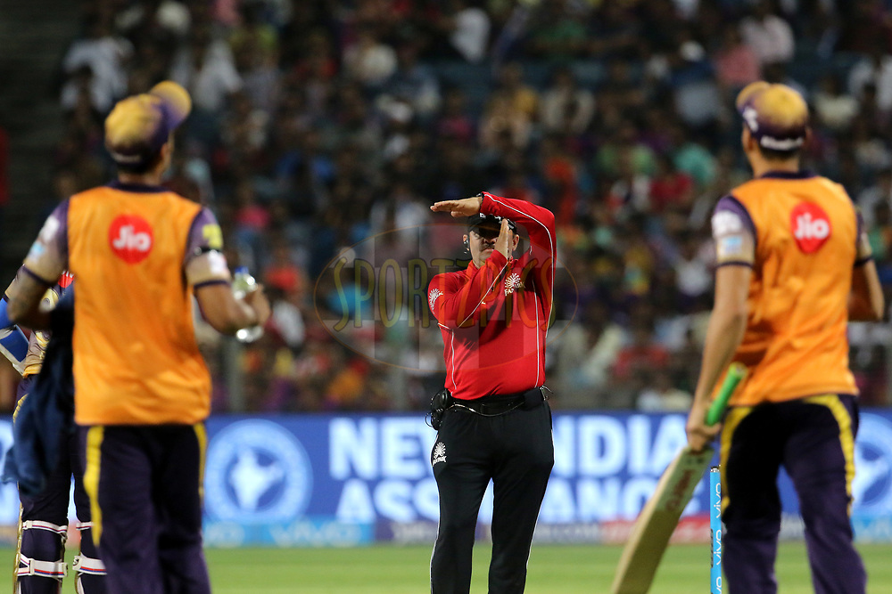 Umpire AY Dandekar signals the strategic time out during match 30 of the Vivo 2017 Indian Premier League between the Rising Pune Supergiants and the Kolkata Knight Riders  held at the MCA Pune International Cricket Stadium in Pune, India on the 26th April 2017<br /> <br /> Photo by Vipin Pawar- IPL - Sportzpics