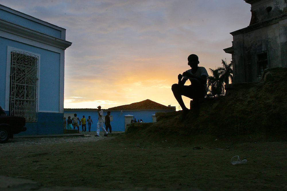 A boy is silhouetted at Sunset in the old colonial town of Trinidad, Cuba.