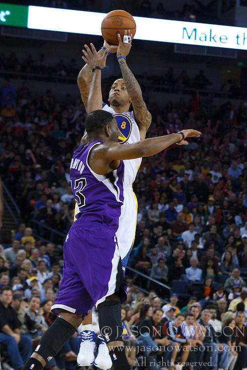 April 10, 2011; Oakland, CA, USA;  Golden State Warriors shooting guard Monta Ellis (8) shoots over Sacramento Kings guard Marcus Thornton (23) during the third quarter at Oracle Arena. Sacramento defeated Golden State 104-103.