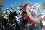 Jeff Dacanay dressed as Captain America participates in a snowball fight in Dupont Circle in Washington, D.C.