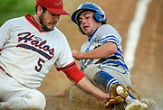 Alexandria Angels pitcher Tyson Gau is a tad late applying the tag to Winner/Colome's Reed Harter as Harter scores on a wild pitch in the third inning of a game on Thursday night in Alexandria. (Matt Gade / Republic)