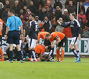 Dundee United&rsquo;s Ryan McGowan and  Sean Dillon comfort Dundee&rsquo;s James McPake after the defender had sustained a serious injury -  Dundee v Dundee United, Ladbrokes Premiership at Dens Park<br /> <br />  - &copy; David Young - www.davidyoungphoto.co.uk - email: davidyoungphoto@gmail.com