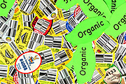 Stickers with UPC codes and other food labels, organic and non-organic used to label produce in stores.