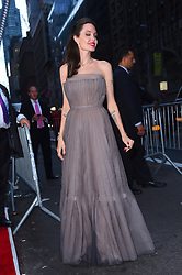 "Newly single Angelina Jolie looks radiant in a strapless pale lavender gown as she stops by the ""First They Killed My Father"" screening at the DGA theater in Midtown. 14 Sep 2017 Pictured: Angelina Jolie. Photo credit: MEGA TheMegaAgency.com +1 888 505 6342"