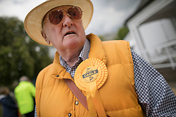 © Licensed to London News Pictures. 28/04/2017. London, UK. A Liberal Democrat supporter stands on Twickenham Green as Vince Cable launches his election campaign in a bid to return to Parliament.  Photo credit: Peter Macdiarmid/LNP