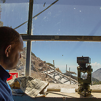 Members of civil protection watch the Colima Volcano, also known as the Volcano of Fire, one of the most active volcanoes in America, from the monitoring unit located on an opposite mountain.