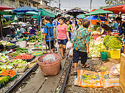 24 MARCH 2015 - MAHACHAI, SAMUT SAKHON, THAILAND:  People walk down the railroad tracks in the market in Samut Sakhon (also called Mahachai), Thailand.    PHOTO BY JACK KURTZ