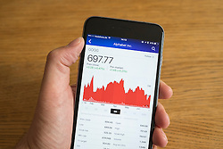 Detail of stock market performance of Google Alphabet company on a smart phone