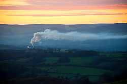 © Licensed to London News Pictures. 19/01/2020. Llandrindod Wells, Powys, Wales, UK. Factory smoke is held down by a temperature inversion caused by a high pressure system situated over the UK. Sub-zero temperatures are forecast for tonight in Powys. Photo credit: Graham M. Lawrence/LNP