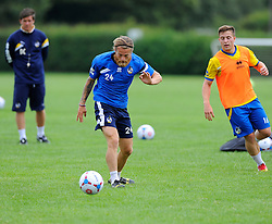 Bristol Rovers' Stuart Sinclair battles for the ball with A Trialist   - Photo mandatory by-line: Joe Meredith/JMP - Mobile: 07966 386802 04/07/2014 - SPORT - FOOTBALL - Bristol - Friends Life Sports Ground - Bristol Rovers Pre-Season training