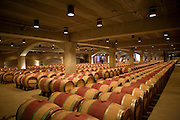 Wine aging in oak barrels at the Robert Mondavi Winery, Napa Valley, California.