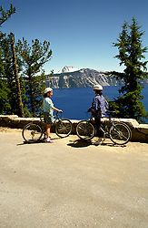 OR:  Oregon; Crater Lake National Park, kids bicycling, model released           .Photo Copyright Lee Foster, lee@fostertravel.com, www.fostertravel.com, (510) 549-2202.Image orcrat206