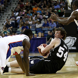 Mar 26, 2011; New Orleans, LA; Butler Bulldogs forward Matt Howard (54) attempts to control the ball as Florida Gators guard Erving Walker (11) and forward/center Patric Young (4) scramble for the ball during the first half of the semifinals of the southeast regional of the 2011 NCAA men's basketball tournament at New Orleans Arena.   Mandatory Credit: Derick E. Hingle