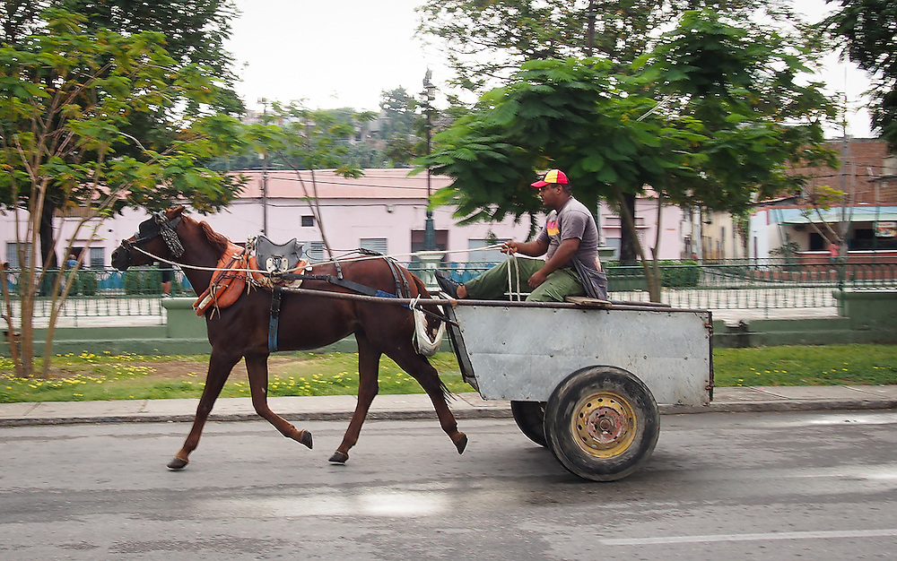 Horse and cart in the early morning Santiago de Cuba.