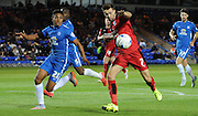 Gwion Edwards lines up a shot during the Capital One Cup match between Peterborough United and Crawley Town at London Road, Peterborough, England on 11 August 2015. Photo by Michael Hulf.