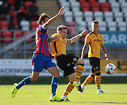 Newport County player Mark Byrne beats Dagenham player Christian Doidge to the ball during the Sky Bet League 2 match between Dagenham and Redbridge and Newport County at the London Borough of Barking and Dagenham Stadium, London, England on 19 September 2015. Photo by Bennett Dean.