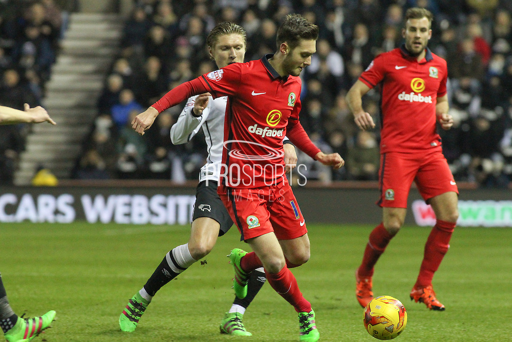 Blackburn Rovers midfielder Matt Grimes on the ball and under pressure during the Sky Bet Championship match between Derby County and Blackburn Rovers at the iPro Stadium, Derby, England on 24 February 2016. Photo by Aaron  Lupton.