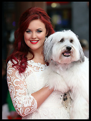 Image licensed to i-Images Picture Agency. 13/07/2014. London, United Kingdom. Ashleigh and  Pudsey at the World premiere of Pudsey The Dog : The Movie in London.  Picture by Stephen Lock / i-Images