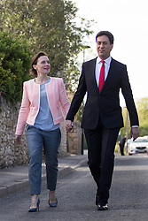 © Licensed to London News Pictures . 07/05/2015 . Doncaster , UK . Labour leader Ed Miliband and his wife Justine Thornton arrive at Sutton Village Hall polling station in Doncaster North to vote at the general election . Photo credit : Joel Goodman/LNP