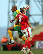 London - Saturday, January 12th, 2008: Grant McCann of Barnsley and Dion Dublin of Norwich City during the Coca Cola Champrionship match at Oakwell, Barnsley. (Pic by Paul Hollands/Focus Images)